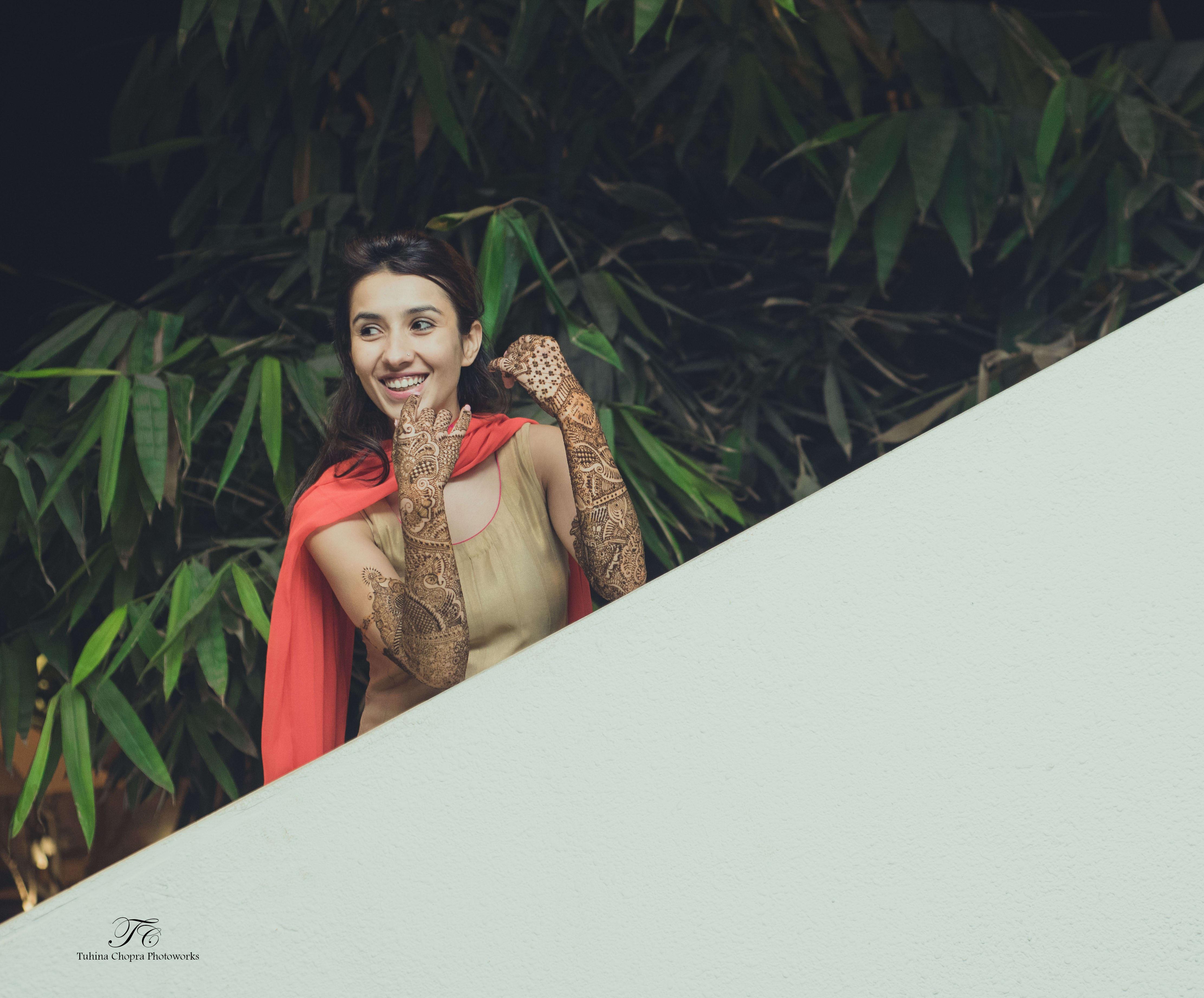 on the day of mehandi:tuhina chopra photoworks