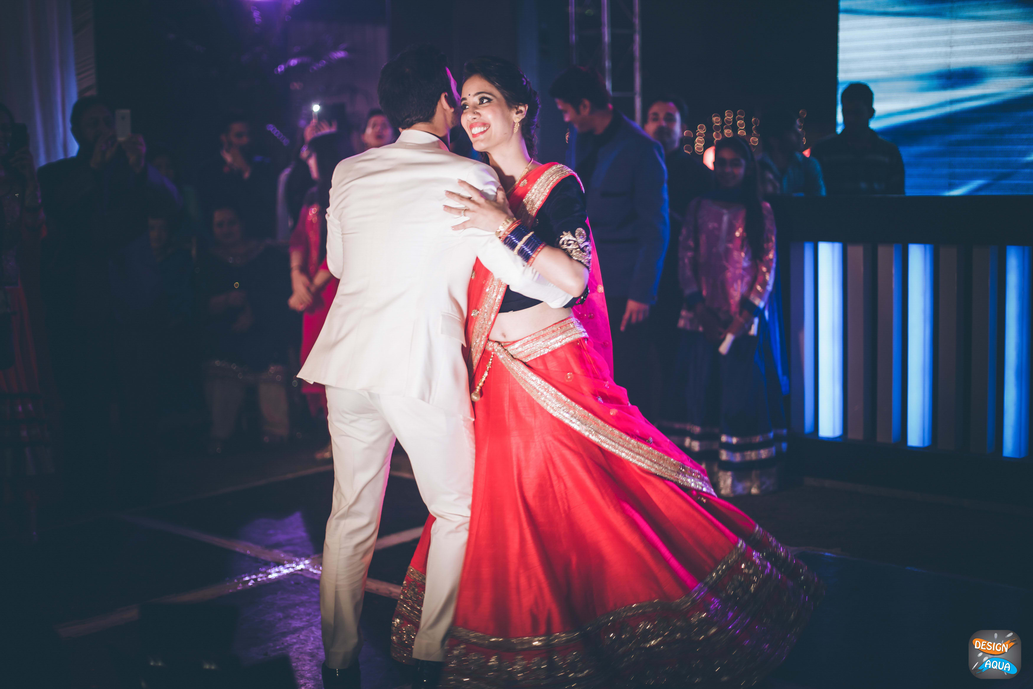 bride and groom dance shot:design aqua, asiana couture, rani pink