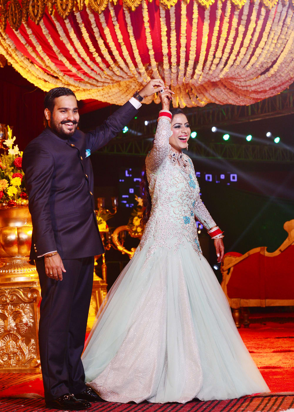 bride and groom dance shot:sabyasachi couture pvt ltd, art capture production