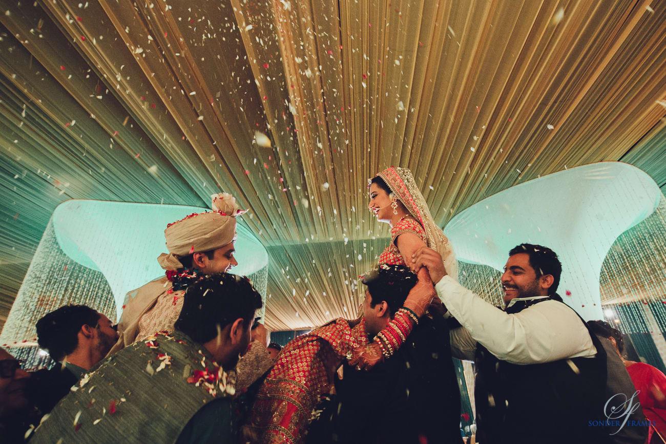 wedding ritual of jaimala:bridal makeup by kajal sharma, sonder frames, stallion events