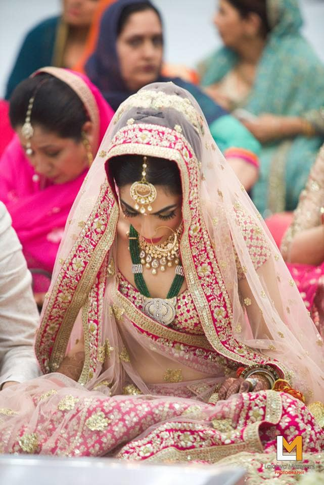 the bride sakshi!:lakshya manwani photography, sabyasachi couture pvt ltd
