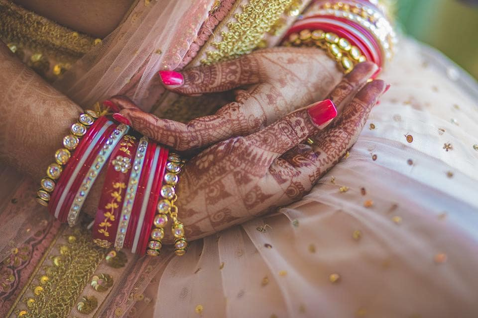 bangles and mehendi:girl in pink photography