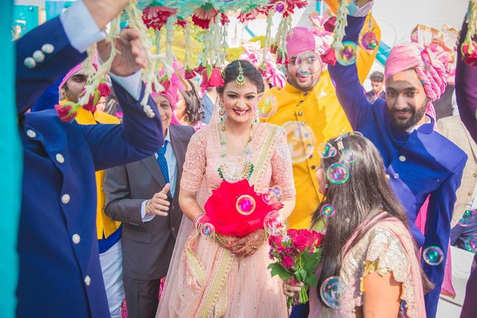 bride under phoolon ki chadar:girl in pink photography