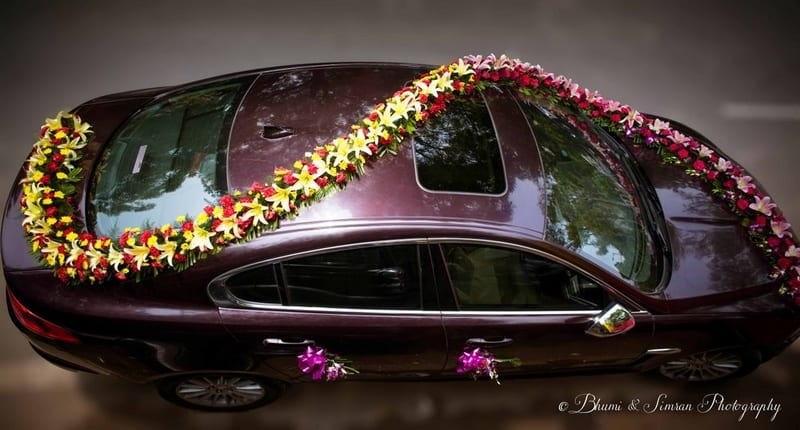 the car decoration!:shri ram hari ram jewellers, hyatt regency delhi, taj palace, bhumi and simran photography, manish malhotra, elements decor, anu kaushik makeup artist, shantanu and nikhil, sabyasachi couture pvt ltd