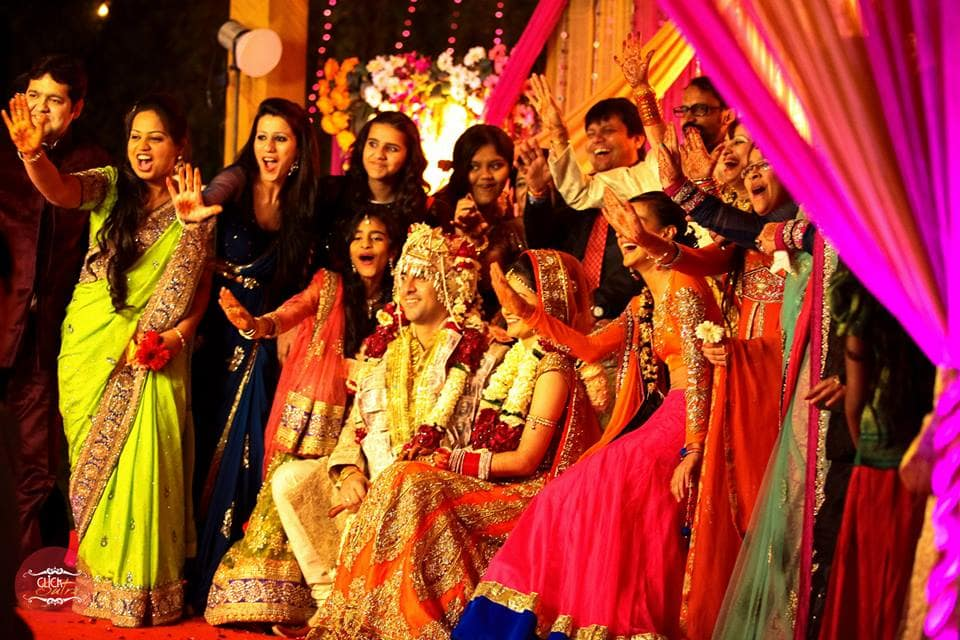 group photograph with bride and groom:click sutra