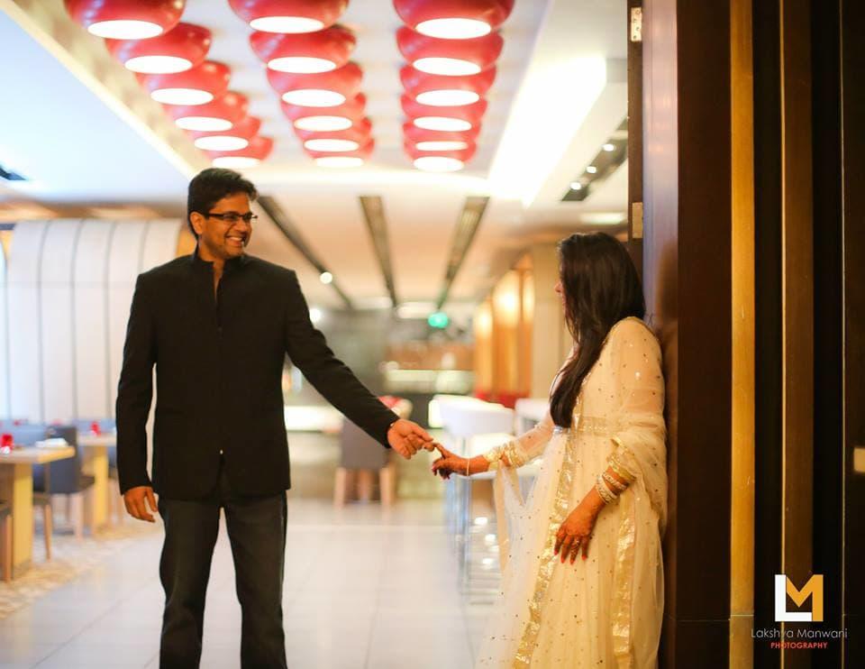 bride and groom holding hands together:lakshya manwani photography