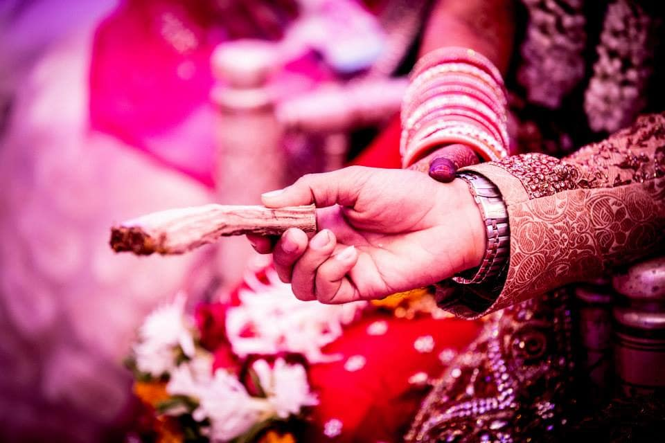rituals performed by bride and groom:girl in pink photography
