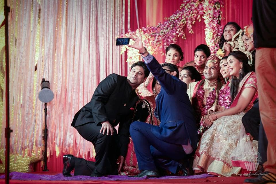 selfie with bride and groom:cupcake productions
