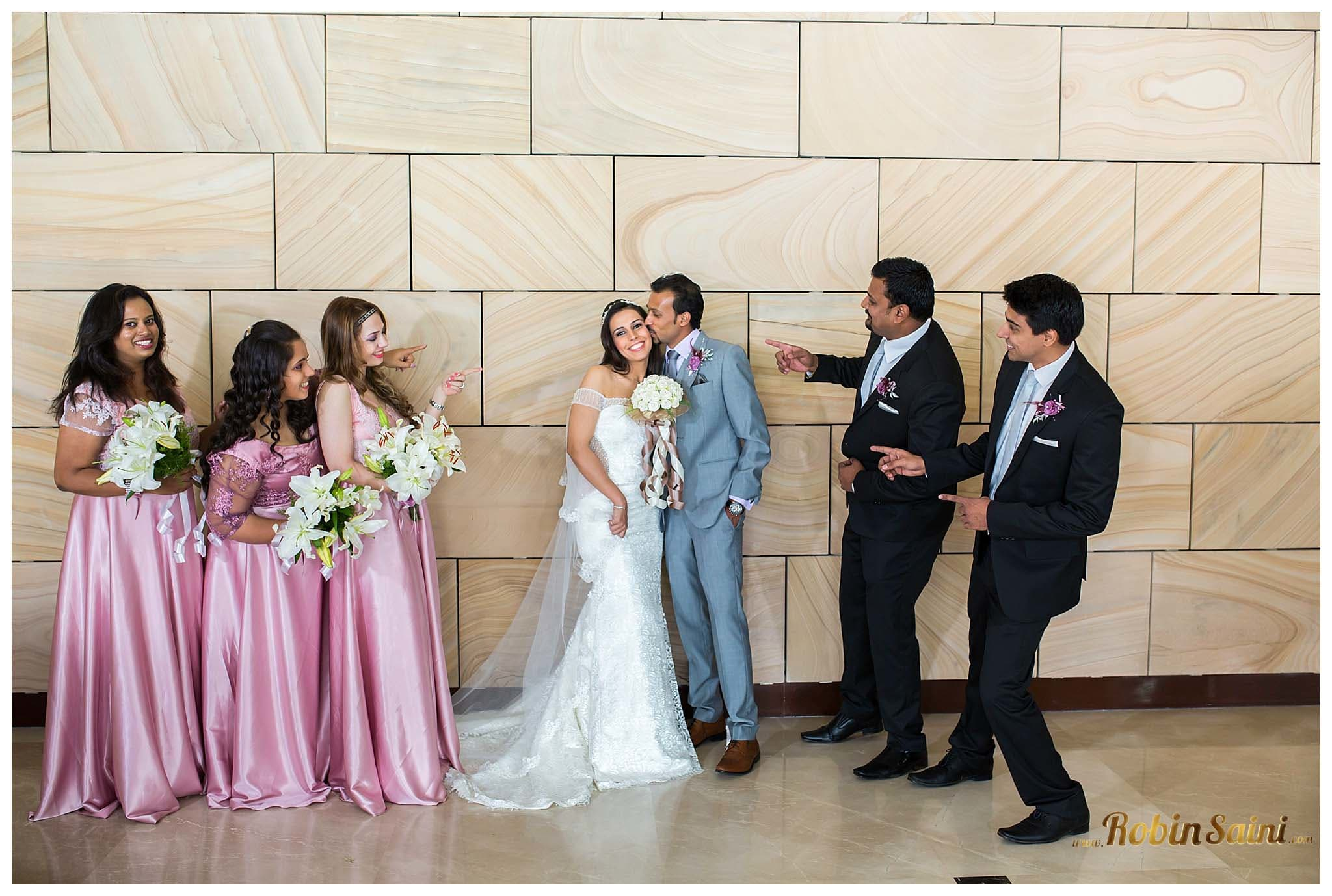 groom kissing bride:robin saini photography