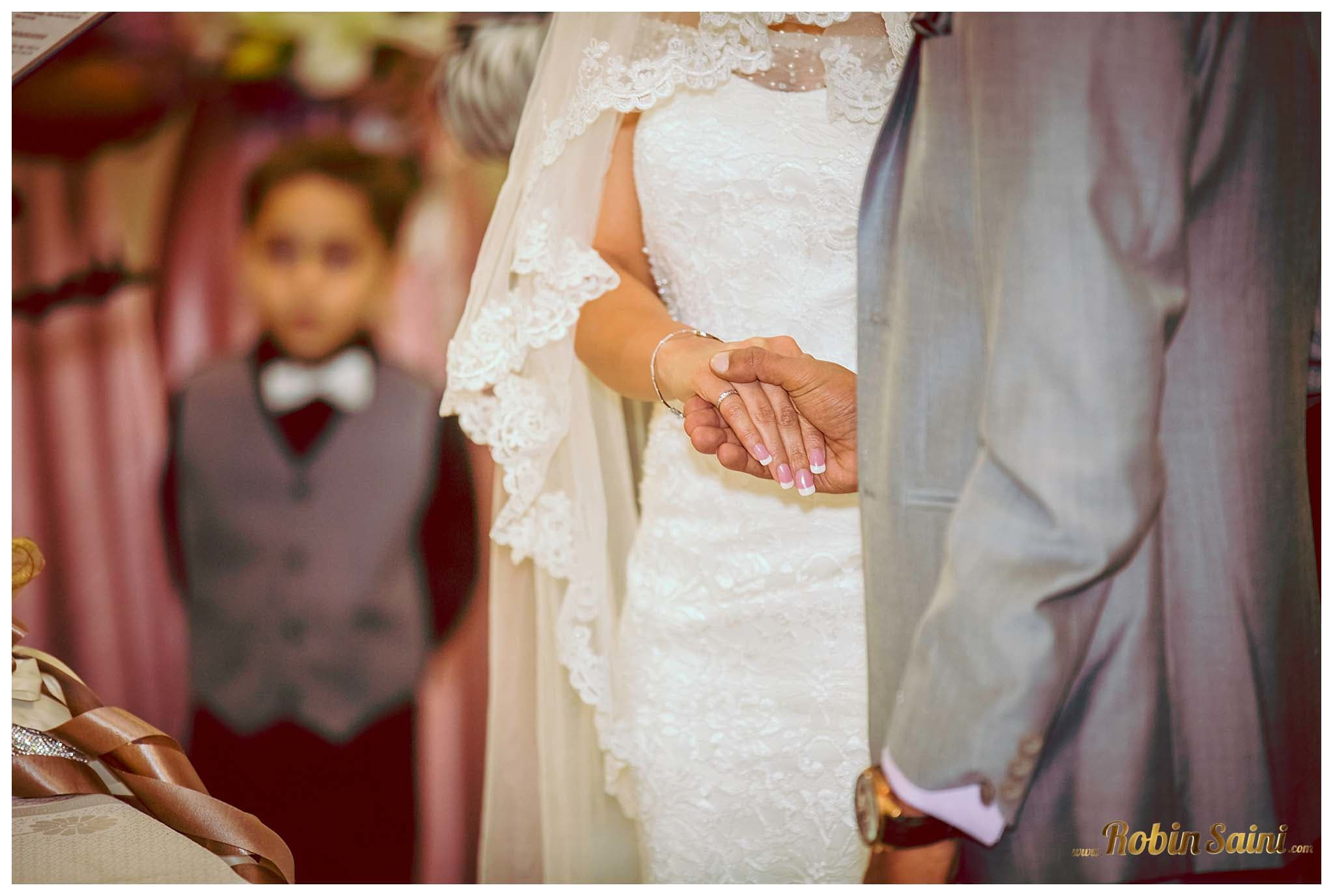 bride and groom holding hands together:robin saini photography
