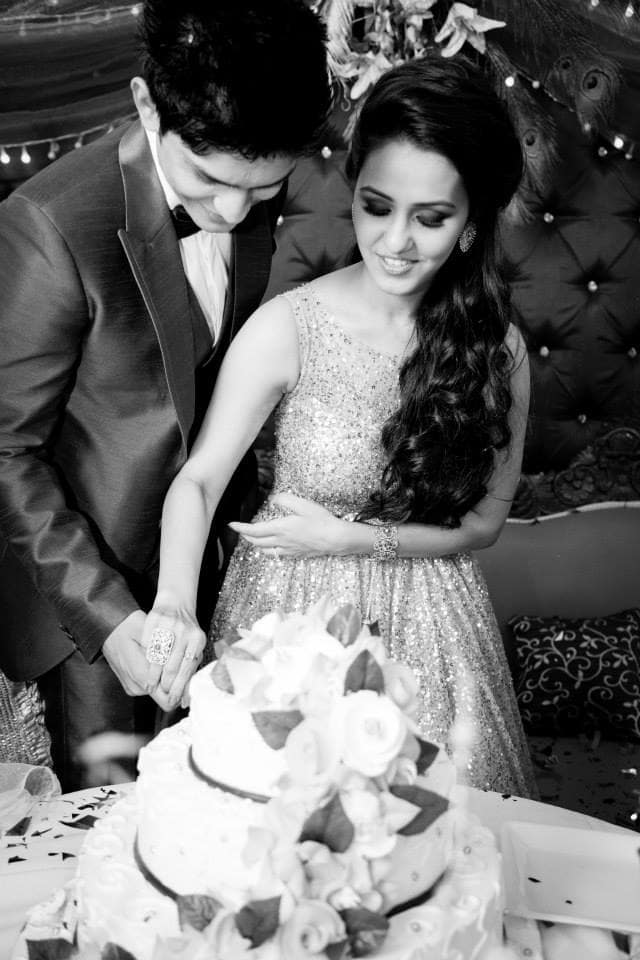 wedding couple cutting cake:girl in pink photography