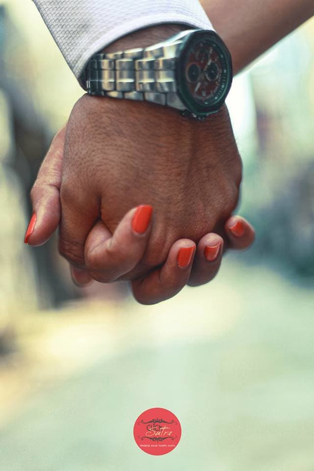couple holding hands together:click sutra