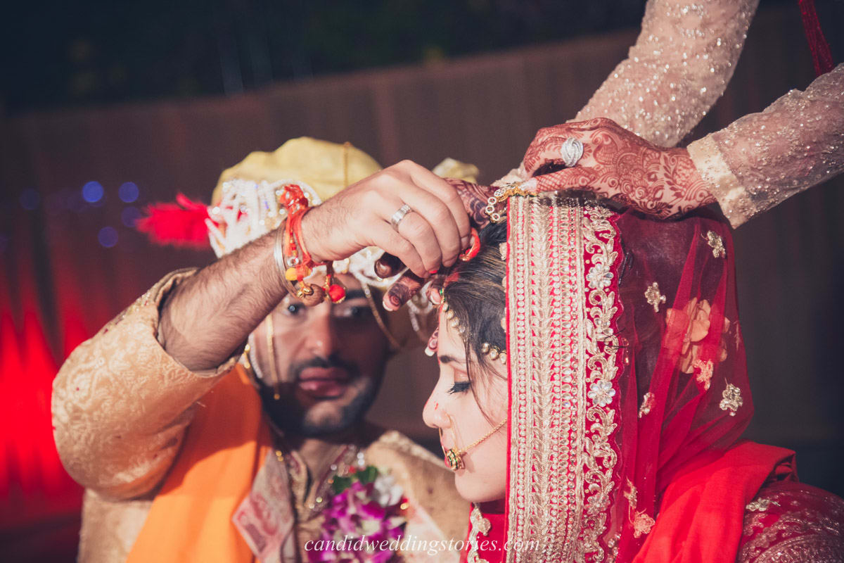 wedding rituals by bride and groom:candid wedding stories