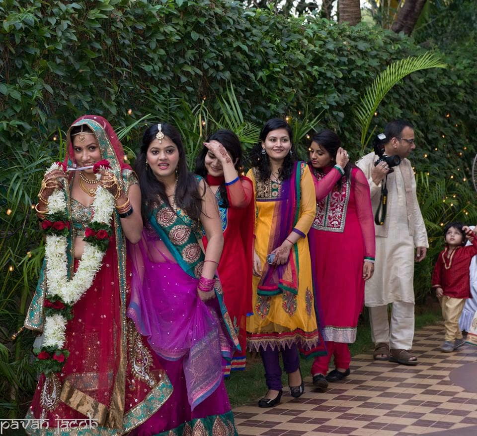 brides entry for varmala ceremony:pavan jacob photography