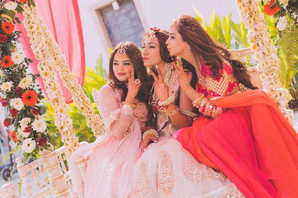 bride posing with friends: