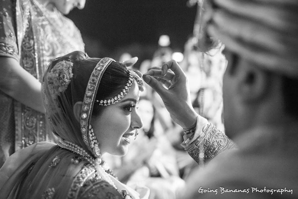 wedding ritual by bride and groom:going bananas photography