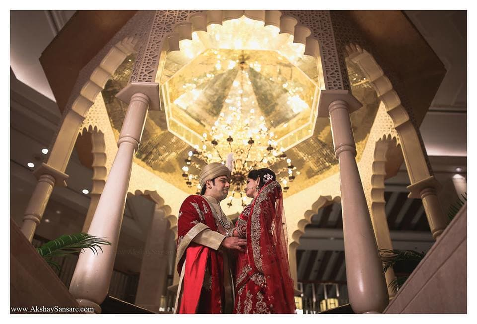 wedding couple in beautiful outfits:akshay sansare photography and films