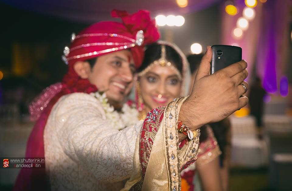 selfie by bride and groom:shutterink photography