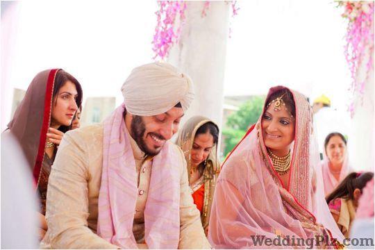 Knotinfocus Photographers and Videographers weddingplz