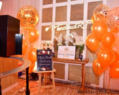 Luxury Graphers Automated Photobooth Photographers and Videographers weddingplz